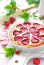 Delicious strawberry tart or cheesecake with fresh berries and cream cheese, closeup Royalty Free Stock Photo
