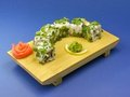 Delicious sushi on wooden plate. Royalty Free Stock Image