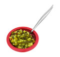 Delicious sweet relish a small red bowl of chopped with spoon Stock Images