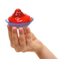 Delicious tasty sweet cake cupcake in human hand. Royalty Free Stock Photo