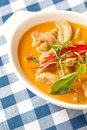 Delicious Thai panang curry in bowl on fabric Royalty Free Stock Images