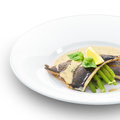 Delicious trout fish fillet grilled and served with basil sause and green beans on white Royalty Free Stock Photo