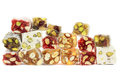 Delicious Turkish delight with nuts on white background. Stock Photo