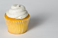 Delicious vanilla bean cupcake black sprinkles white deep shadow Stock Images