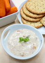 Delicious vegetable dip a creamy crab surrounded by vegetables and crackers at a party Stock Images