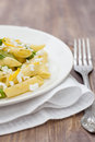 Delicious vegetarian pasta with green peas and feta cheese Stock Image