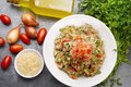 Delicious vegetarian quinoa salad with parsley, tomato and onion Royalty Free Stock Photo