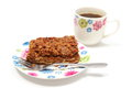 Delicious walnut cake on colorful plate and cup of coffee white background piece fresh fork lying black Royalty Free Stock Image