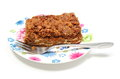 Delicious walnut cake on colorful plate white background piece of fresh and fork lying Royalty Free Stock Photo