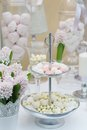Delicious wedding sweets yellow and pink table set Stock Photography