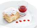 Delicious and yummy napoleon cake with confectioners sugar berry topping on a round plate Stock Photos