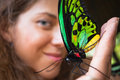 Delight of girl holding a butterfly on a hand Royalty Free Stock Images