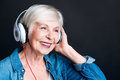 Delighted Aged Woman Listening...