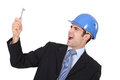 Delighted businessman in a hardhat with a doorkey Stock Images