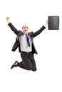 Delighted businessman jumping out of joy isolated on white background Royalty Free Stock Images