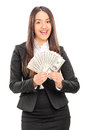Delighted businesswoman holding a stack of money isolated on white background Royalty Free Stock Image