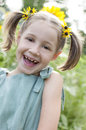 Delighted child in sunflower dress girl a sits a field of sunflowers Stock Photo