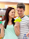 Delighted couple buying products Stock Photo