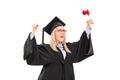 Delighted female student celebrating graduation isolated on white background Stock Image