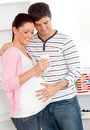 Delighted pregnant woman holding a glass of milk Stock Images