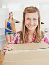 Delighted woman holding boxes after moving Stock Image
