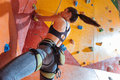 Delighted woman training hard in climbing gym Royalty Free Stock Photo