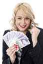 Delighted young woman holding money currency attractive Stock Photo