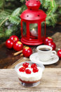 Delightful tiramisu dessert decorated with cherries christmas setting cup of coffee and red lantern in the background italian xmas Royalty Free Stock Images