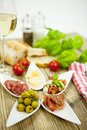 Deliscious antipasti plate with parma parmesan olives Stock Image