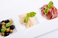 Deliscious antipasti plate with parma parmesan and olives Royalty Free Stock Images