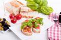 Deliscious fresh bruschetta appetizer with tomatoes  Stock Images