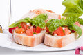 Deliscious fresh bruschetta appetizer with tomatoes  Royalty Free Stock Photos