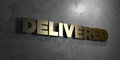 Delivered - Gold sign mounted on glossy marble wall - 3D rendered royalty free stock illustration