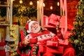 Delivering gifts. Santa Claus near christmas tree. Merry christmas. Bearded senior man Santa Claus. Santa Claus relaxing Royalty Free Stock Photo