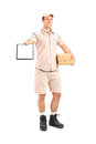 Delivery boy holding a packet and giving a clipboard for signatu full length portrait of signature isolated on white background Royalty Free Stock Photos