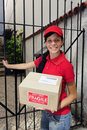 Delivery courier or mailman delivering package Royalty Free Stock Photo