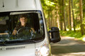 Delivery courier in van on the way Royalty Free Stock Photos