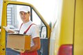 Delivery man with box courier in front of cargo van delivering package carton Stock Image
