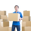 Delivery man carry cardboard box Stock Images