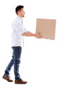 Delivery man carrying a box isolated over white background Stock Photos