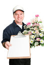 Delivery man from florist carrying a bouquet of flowers and a message for you on a clipboard isolated on white blank paper ready Stock Images