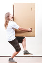 Delivery man holding a paper box. Royalty Free Stock Photo