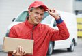 Delivery man with package outdoors Royalty Free Stock Photo