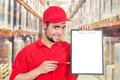 Delivery man with a tablet Royalty Free Stock Image