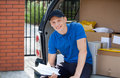 Delivery man taking break from work Royalty Free Stock Photo