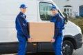 Delivery Men Carrying Cardboar...