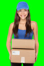 Delivery person holding packages wearing blue cap woman courier smiling happy isolated on green screen chroma key background Royalty Free Stock Photography
