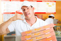 Delivery service - man holding pizza boxes Stock Image