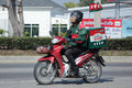Delivery service man ride a Motercycle of The Pizza Company. Royalty Free Stock Photo