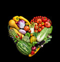 Deluxe heart symbol vegetables diet concept food photography of made from different vegetables on black background high Stock Photos